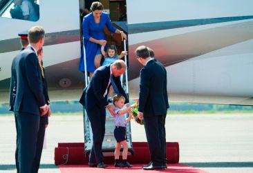 Britain's Prince William, Duke of Cambridge, and his wife Kate, the Duchess of Cambridge with their children Prince George and Princess Charlotte arrive at the airport in Berlin on July 19, 2017. The British royal couple is on a three-day-visit in Germany. / AFP PHOTO / POOL / STEFFI LOOSSTEFFI LOOS/AFP/Getty Images