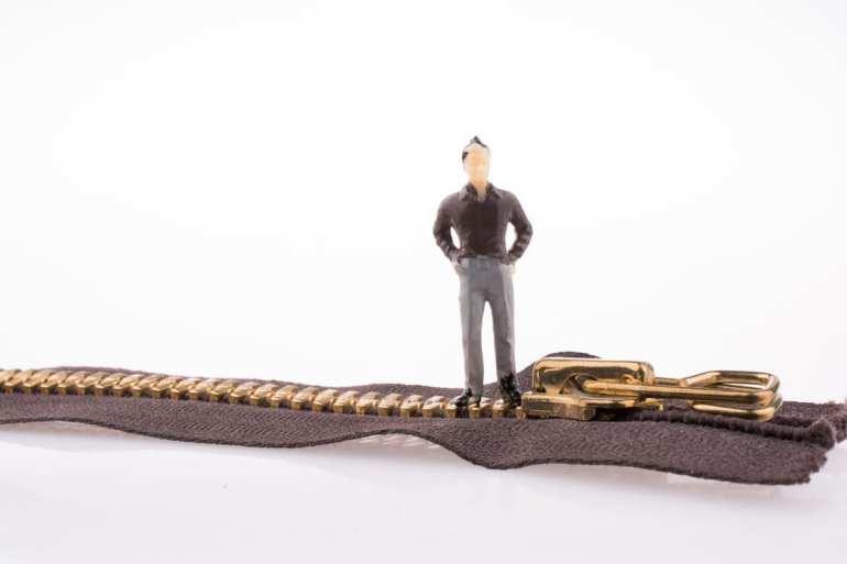 man standing on zipper