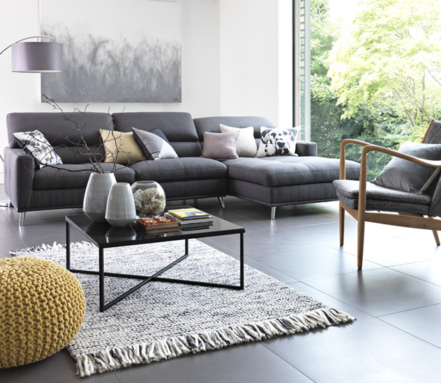 Grey Furniture and Accessories   Argos Large grey corner sofa in living room area with scatter cushions and yellow  knitted footstool