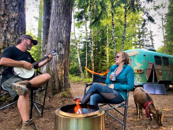 Chad, Cate and Frankie the goat boondocking in the National Forest