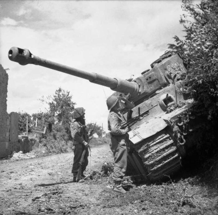 Men of the Durham Light Infantry, 49th (West Riding) Division inspect a knocked-out German Tiger tank during Operation 'Epsom', 28 June 1944.