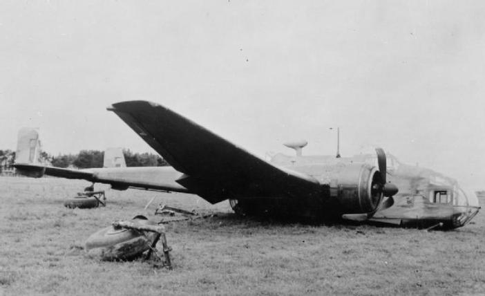 On 2 August 1943, Hampden torpedo bombers of No 455 Squadron RAAF attacked a convoy off the Norwegian coast. This aircraft (L4105/D) suffered massive flak damage to its tail - half the elevator was blown away, the starboard fin twisted and the port rudder fouled by debris. The crew were forced to lash a rope around the rudder bar and took turns helping the pilot, Flying Officer Iain Masson, hold the aircraft straight as they limped back to Leuchars for a crash-landing.