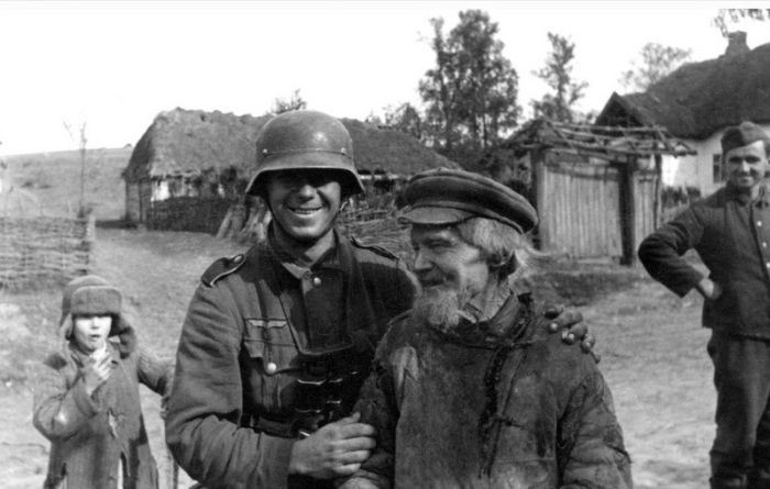 German Soldier together with a Russian senior citizen.