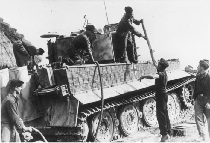A Tiger Tank receives new fuel and ammo on the Eastern Front.