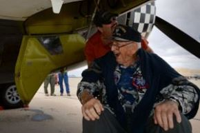 Retired Air National Guard Chief Warrant Officer 2 Robert Hertel is wheeled around a P-47 Thunderbolt during the Heritage Flight Training and Certification Course at Davis-Monthan Air Force Base, Ariz., Feb. 28, 2015. Hertel flew the Thunderbolt over Iwo Jima, Japan during World War II and had not seen one since the 1960's. (Credit: U.S. Air Force photo by Senior Airman Jensen Stidham)