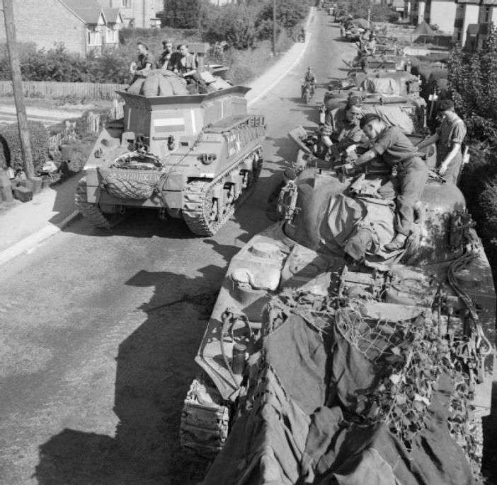 A Sherman BARV and Sherman tanks of 13th-18th Royal Hussars during the regiment's move from Petworth to Gosport. 2 June 1944