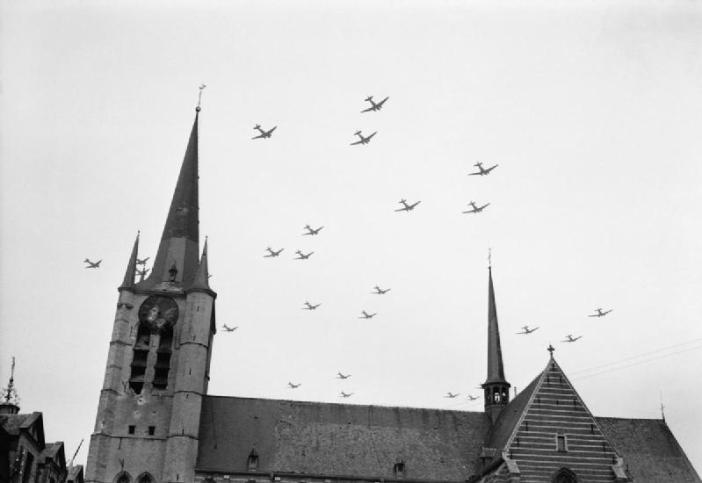 American C-47 aircraft flying over Geel in Belgium on their way to Holland for Operation Market Garden, 17 September 1944.