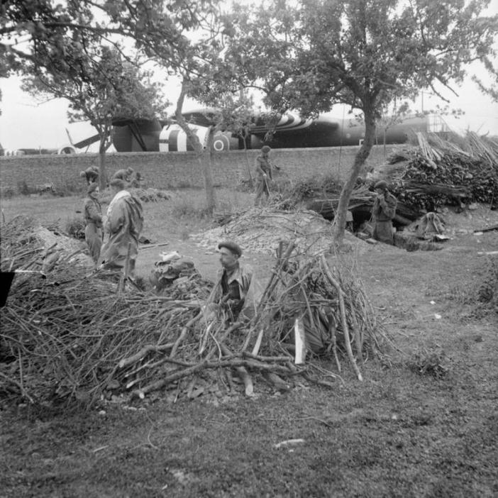 Men of No. 3 Commando dig in beside a Horsa glider near La Haute Ecarde, on the western end of DZ 'N' between Ranville and Sallenelles, after the link-up with 6th Airborne, 6 June 1944.