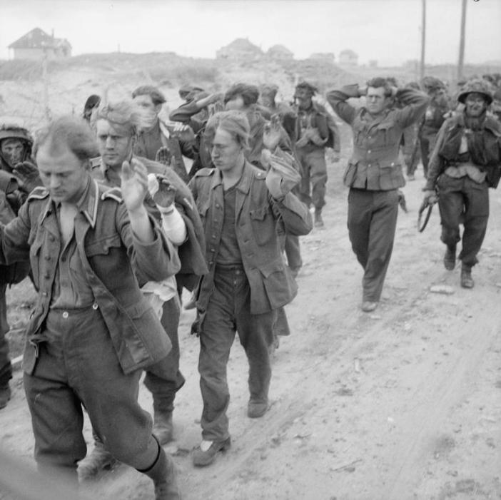 German prisoners being marched along Queen beach, Sword area, 6 June 1944.