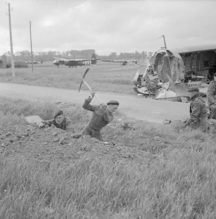 Commandos of 1st Special Service Brigade digging in near Horsa gliders on 6th Airborne Division's landing zone east of the River Orne, near Ranville, on the evening of 6 June 1944.
