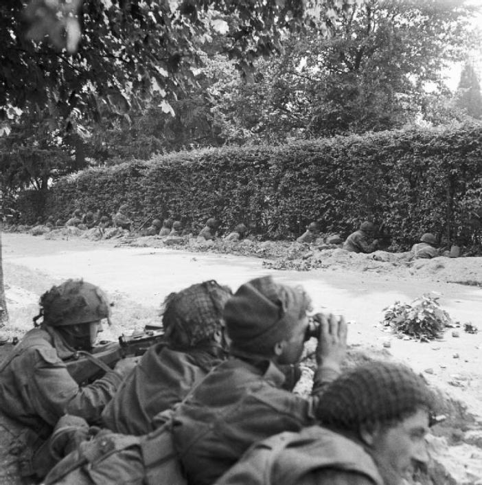 Men of C Company 1st Battalion, Border Regiment, waiting in ditches beside the road, ready to repulse an attack by the enemy who were barely 100 yards away.