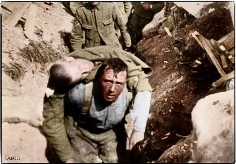"""A Still from the film 'The Battle of the Somme' showing a British soldier carrying a wounded comrade back from the front line. The scene is generally accepted as having been filmed on the first day of the battle, 1 July 1916."" (This man died 30 minutes after reaching the trenches)"