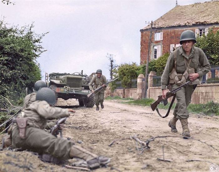 G.I.'s from (possibly) the 1st Btn, 314th Inf. Rgt. of the US 79th Inf. Div., during an attack on the Bolleville road, just north west of La Haye Du Puis in Normandy. c. 8th July 1944