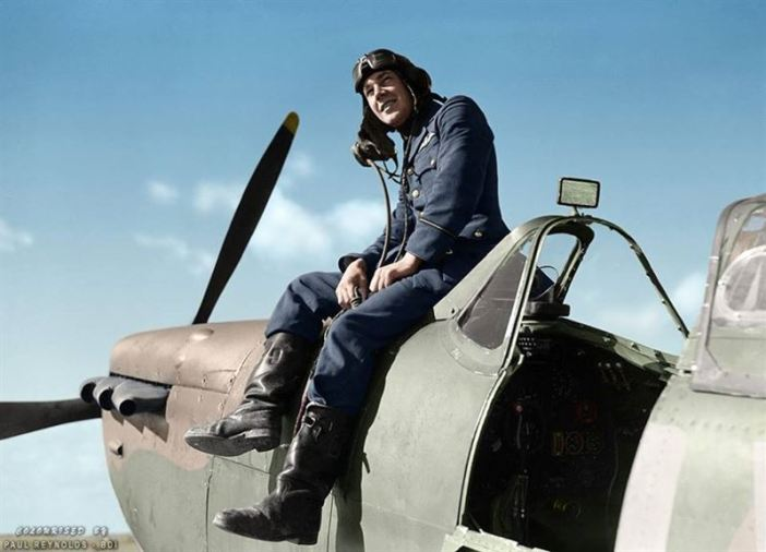 Flying Officer Leonard Haines of No. 19 Squadron RAF sits by the cockpit of his Supermarine Spitfire Mk.Ia (QV-?) at Fowlmere, near Duxford. September 1940.