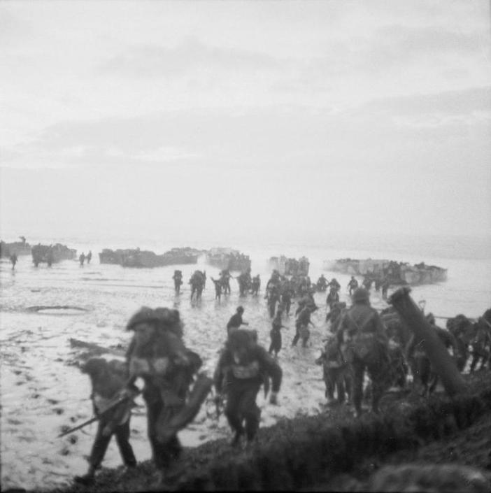 The Battle for Walcheren Island: Men of the 4th Special Service Brigade wade ashore from landing craft near Flushing to complete the occupation of Walcheren.