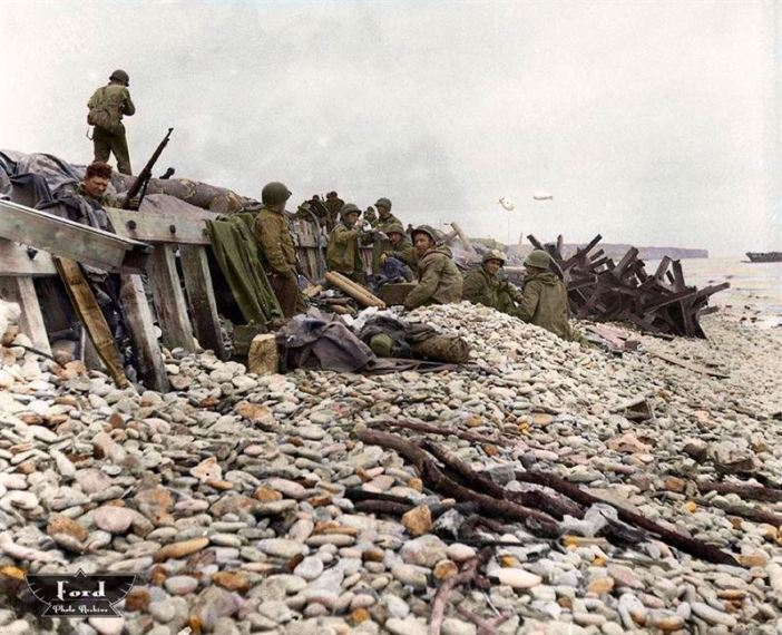 D Day plus one (7th June 1944). On the shingle of Omaha Beach Dog White sector, at Saint-Laurent sur Mer, Normandy.