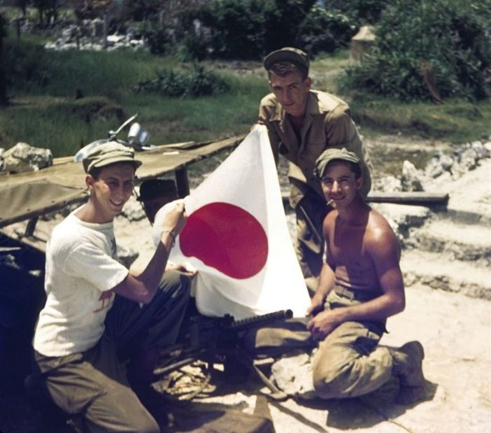 Captured Japanese flag and 30 cal machine gun.