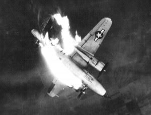 A U.S. Army Air Forces Martin B-26G-11-MA Marauder (s/n 43-34565) from the 497th Bombardment Squadron, 344th Bombardment Group, 9th Air Force, enveloped in flames and hurtling earthward after enemy flak scored a direct hit on left engine while aircraft was attacking front line enemy communications center at Erkelenz, Germany.