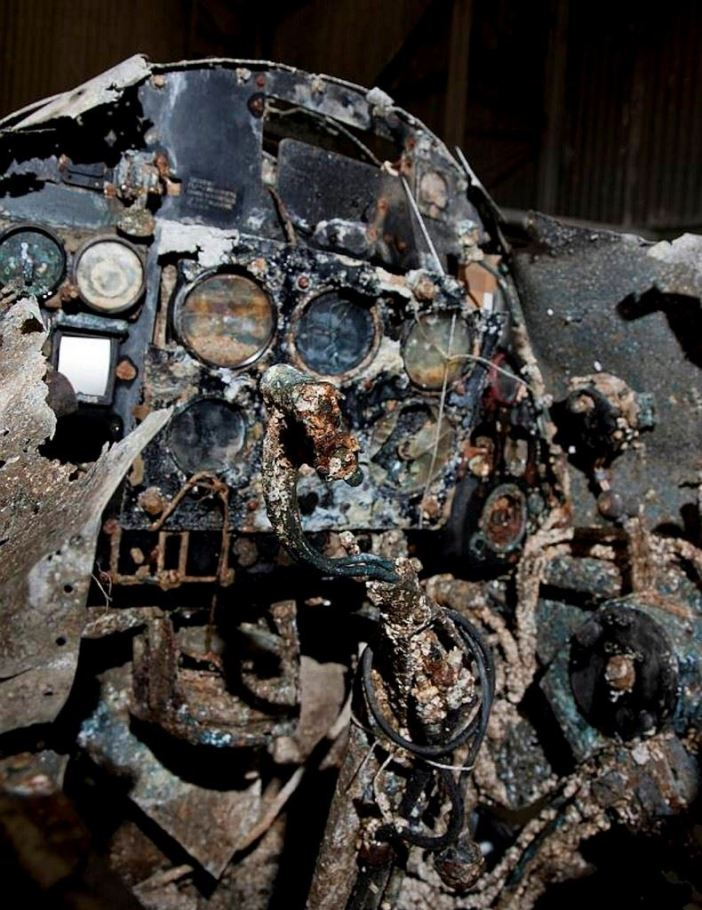 The cockpit of the Spitfire shows the condition the aircraft was in when found, right down to the sand in the gauges. (Credits: Commonwealth of Australia)