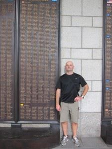The author, in a 2013 trip to Seoul, Korea, stands next to a bronze memorial plaque at the War Memorial Museum of Korea that bears the name of a relative who gave his life during the Korean War. (Credits: Stephan Hamilton via Helion)