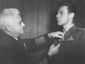 One Marine assigned to covert activities in Europe with the Office of Strategic Services (OSS) was Capt Peter J. Ortiz, who was twice decorated with the Navy Cross. Here he receives his first Navy Cross from Admiral Harold R. Stark in London