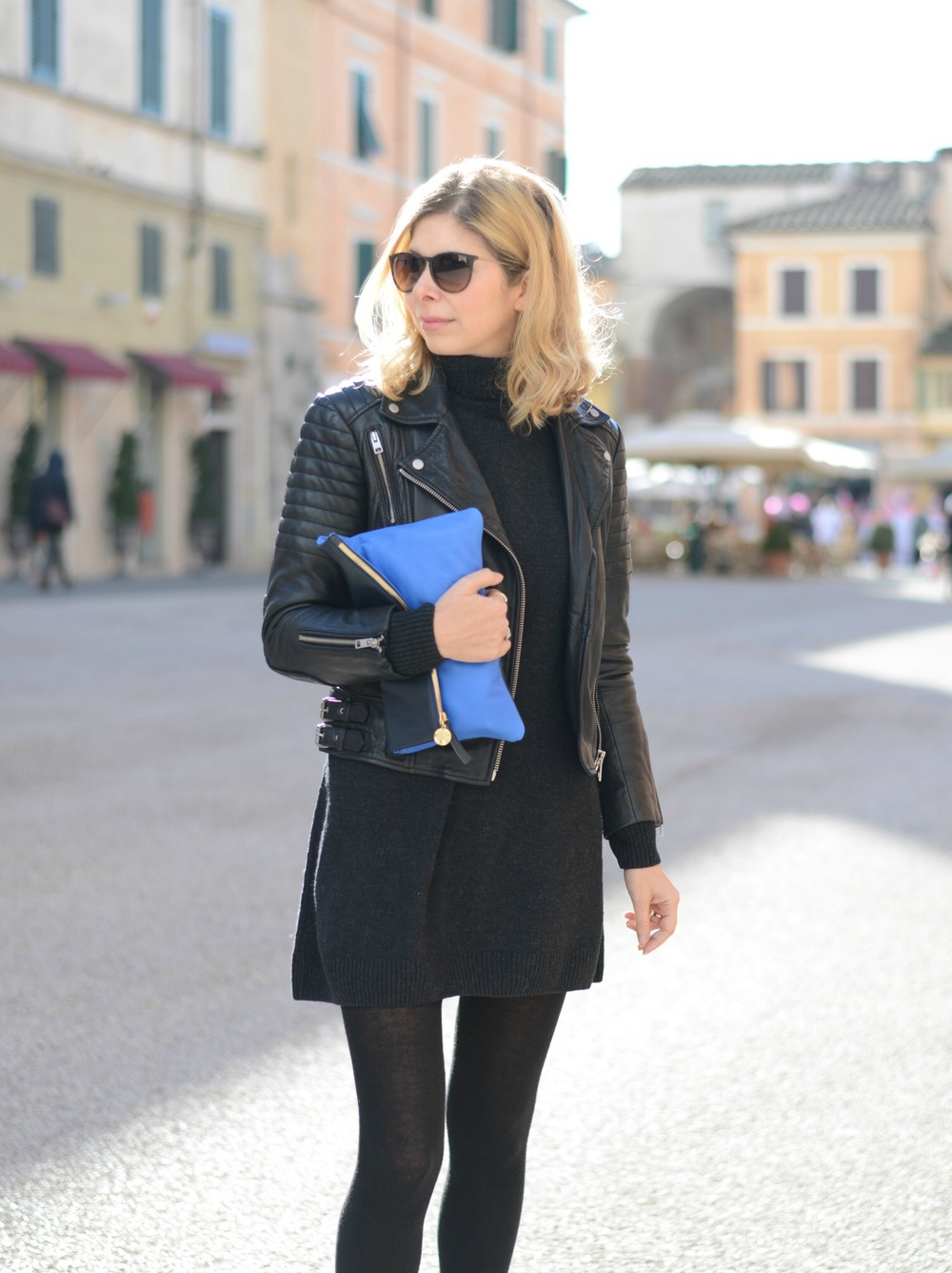 Wearing Allsaints leather jacket, Clare Vivier clutch, Cos jumper dress, Rayban glasses.