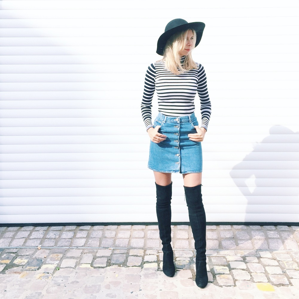 Arianna Trapani is wearing ASOS Denim skirt, Stuart Weitzman Highland boots, Sandro stripe high neck jumper and Topshop hat.