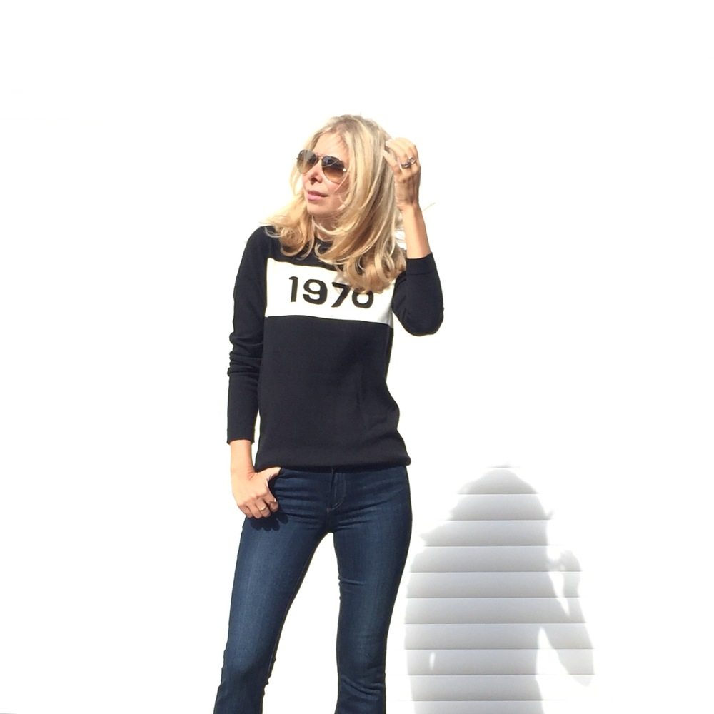 Arianna Trapani is wearing Bella Freud jumper, Paige flared denim jeans, Rayban sunglasses.