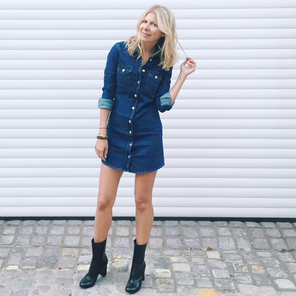 Arianna Trapani is wearing Topshop Denim dress, Russell & Bromley boots, Mansur Gavriel bucket bag and Topshop hat during London Fashion Week.