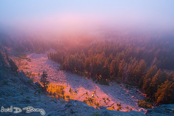 Incredible firey foggy sunset from the rim of Crater Lake