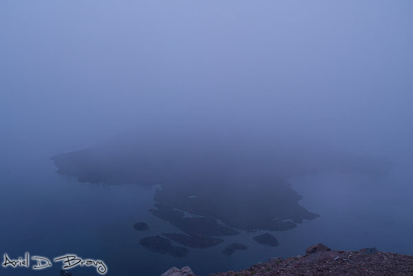Wizard Island through the fog after sunset