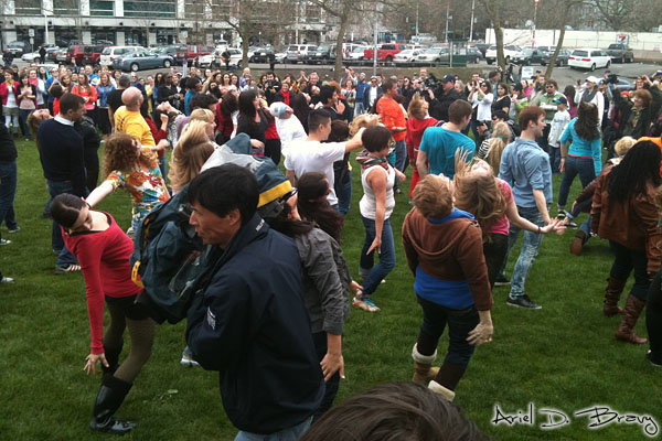 The A-team and B-team dances at Seattle Center before the big crowd joins in as a news guy walks by