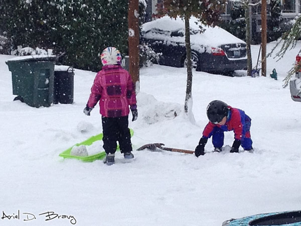 Little kids playing in the snow