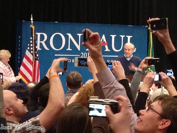 People recording the cheering as the room explodes for Ron Paul