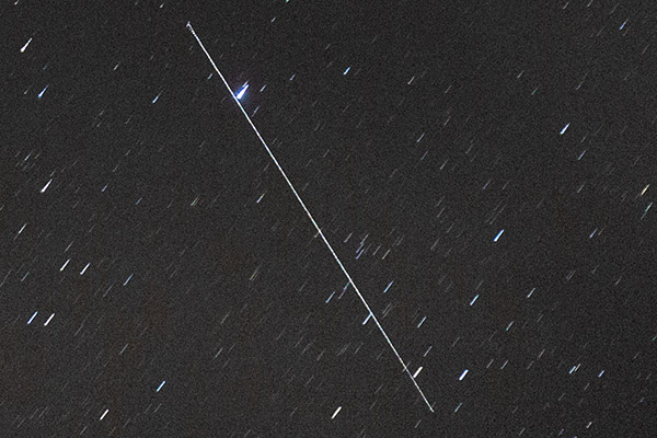 Satellite streak long exposure zoomed in