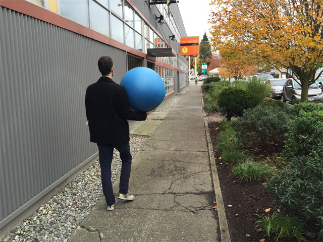 Glenn carrying ball at Portage Bay