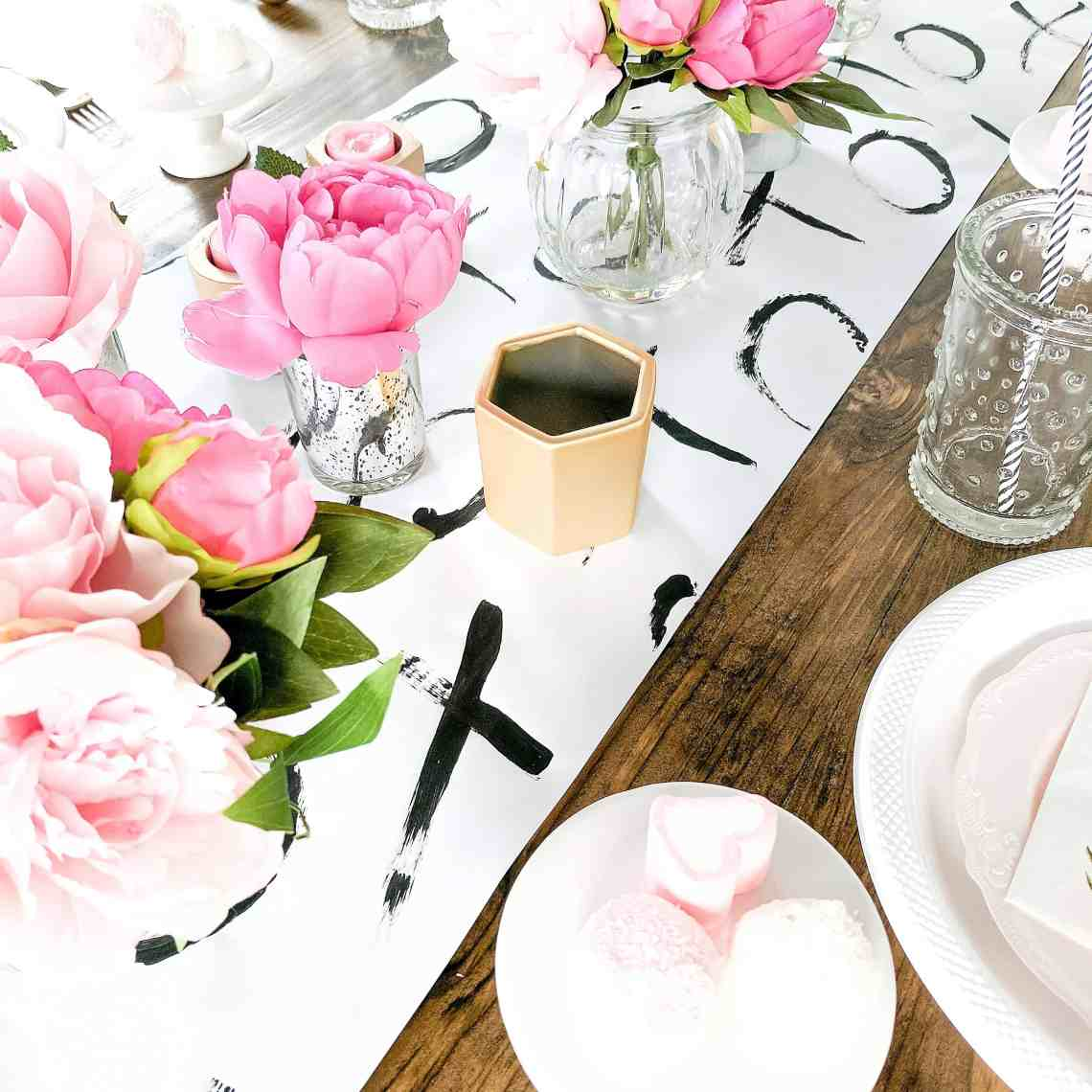 Black and white table runner with floral and gold accents