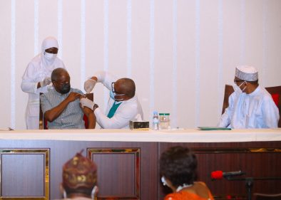 PRESIDENT BUHARI & VP OSINBAJO RECEIVES COVID-19 VACCINATION. . President Muhammadu Buhari Looks on as Vice President Yemi Osinbajo SAN receives COVID-19 Vaccination from his Personal Physician, Dr Nicholas Audifferen at the State Hose abuja.