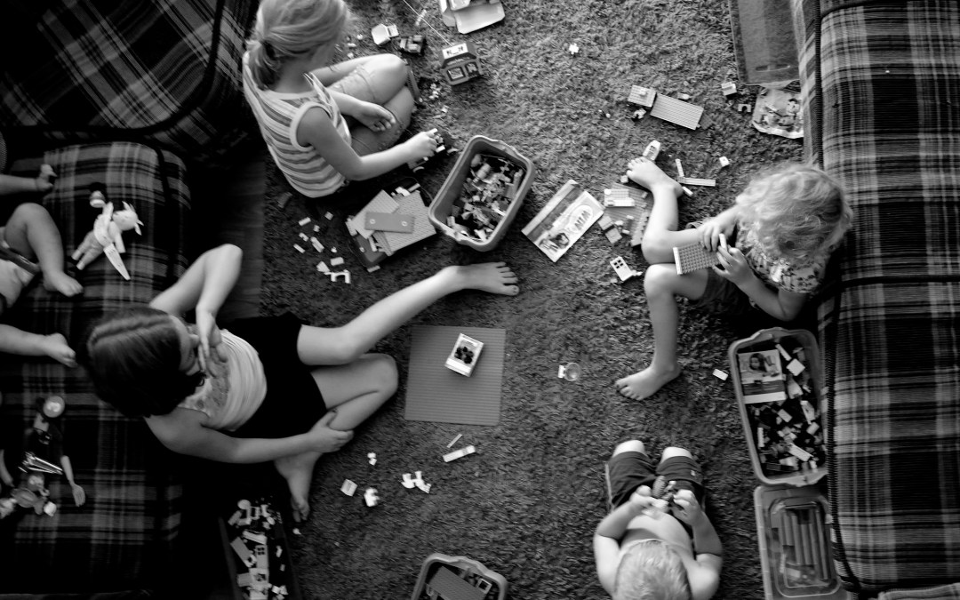 kids playing with lego in a messy pile - are your kids volatile, uncertain, complex, and ambiguous