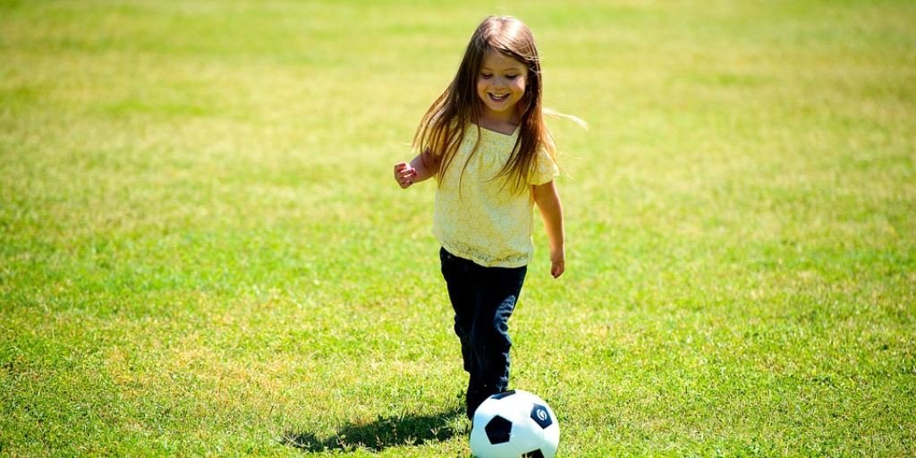 Girl playing soccer - funding extracurricular activities