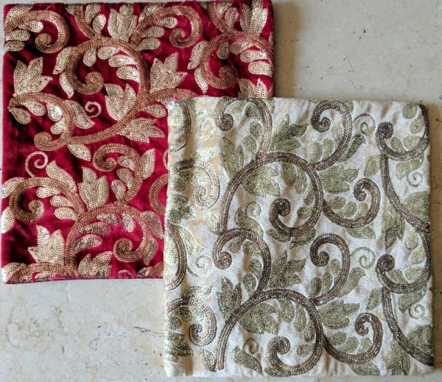 Red, white and gold cushion covers