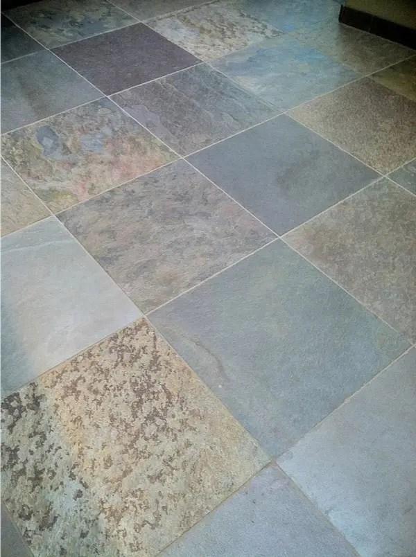dull slate floor tile before cleaning