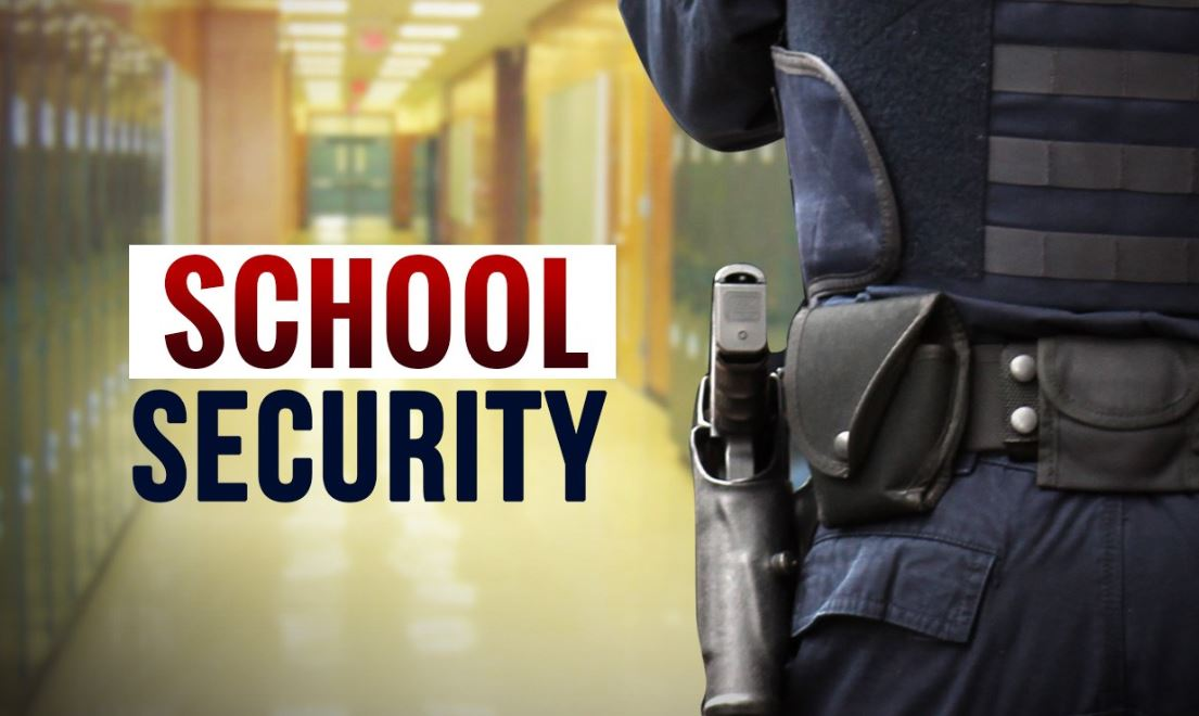 School Security with officer, gun and hallway_1552573885506.JPG-118809306.jpg