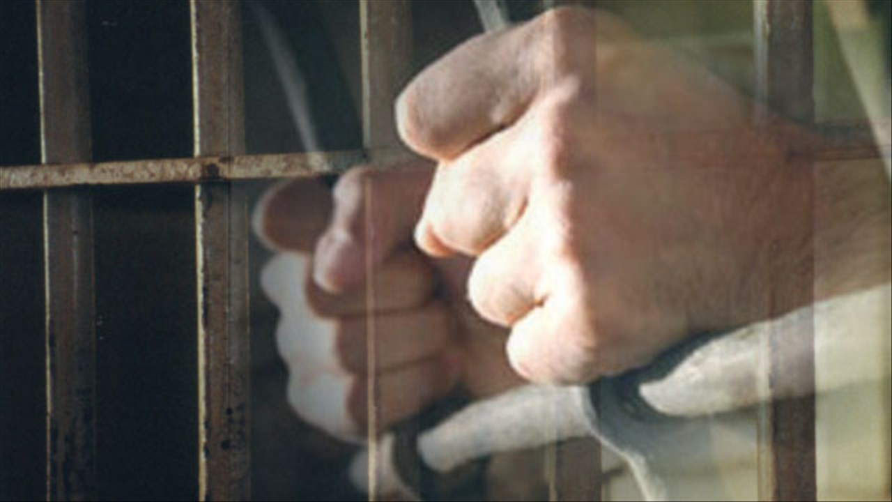 Prison inmate jail bars