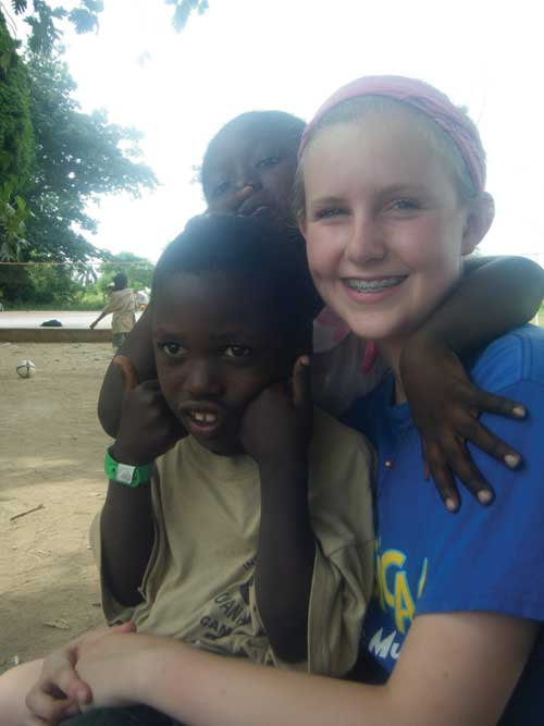 Freshman Madeline English spends time with the Haitian children at the Bible school her church organized. Photo courtesy Madeline English.