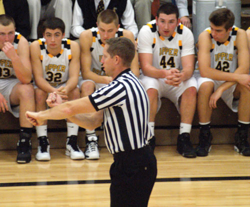 A referee in the Golden Bears basketball game against Thomas Worthington, calls a foul on one of the players. Whatever the outcome may be, players, coaches, and viewers, must respect the decision.