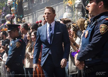James Bond (Daniel Craig), in pursuit of an assassin, searches through a crowd of Day of the Dead celebrators in the opening of Spectre. (Eon Productions)