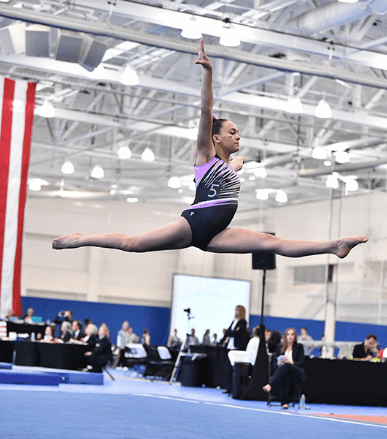 Sophomore Caitlyn Bates leaps. Bates has trained in gymnastics since she was 3 years old. Photo courtesy Caitlyn Bates