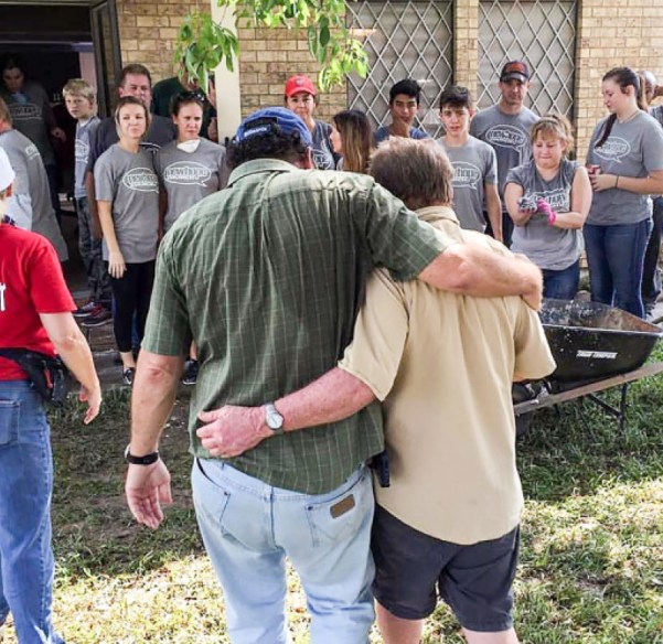 Two survivors of the hurricane are seen thanking the group from New Hope Church after they rebuilt the couples home. Image Courtesy New Hope Church
