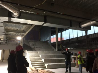 Potts explains the new Learning Stairs, a collaborative space within the Learning Center.